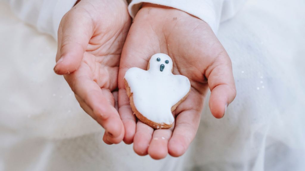 Girl holding ghost biscuit
