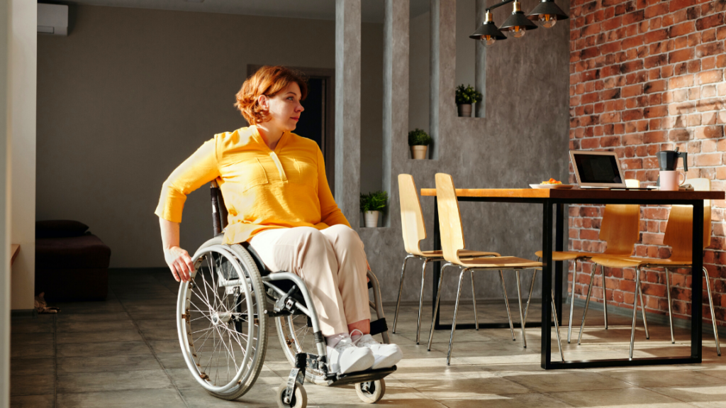 woman in an accessible workplace after seeing an inclusive job description and her colleagues making the workplace accessible.