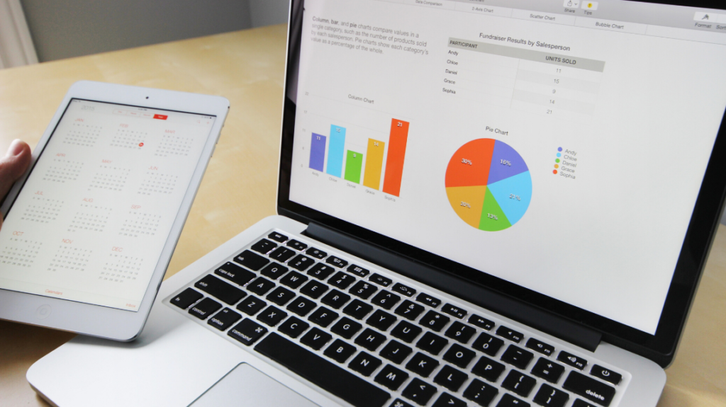 looking at statistics in an informative manner after hiring a ppc expert. photo by pixabay from pexels