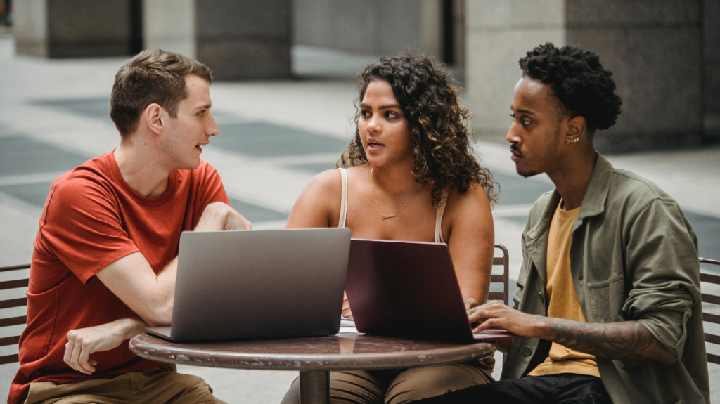 three colleagues working well together after taking steps to improve unconscious bias training. photo by william fortunato from pexels