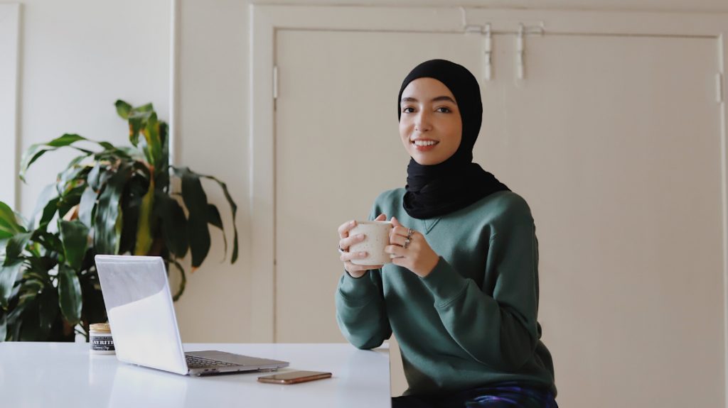 Gen Z employee with a hijab in a bright workplace