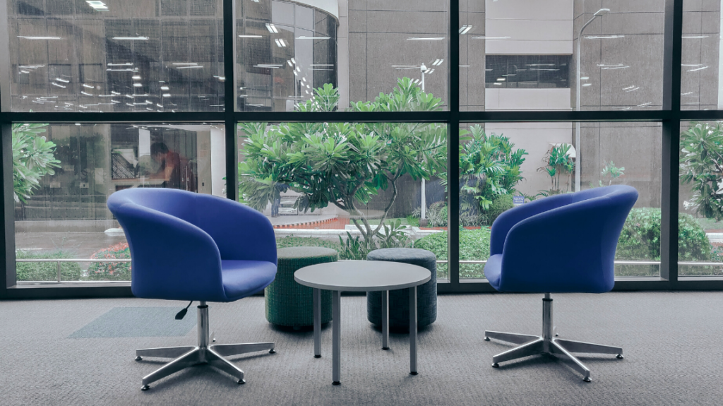 Two blue conference chairs at a trendy tech company office