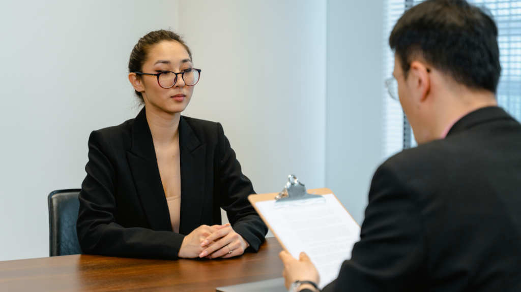 Candidate and employer in business wear at an interview